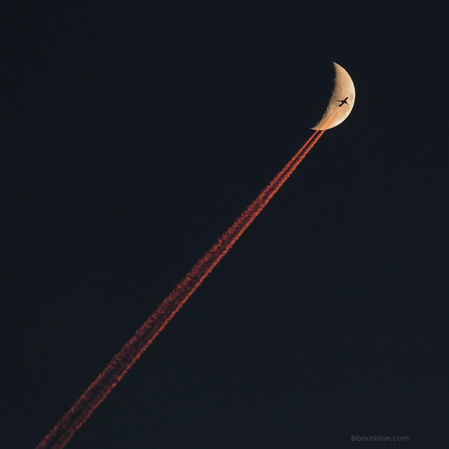 Plane Crossing a Crescent Moon